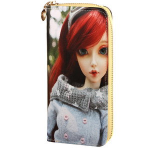 Women's wallet with 3D doll image. Includes a hand strap and lots of pockets. Size: 9cm, w 19cm, 3cm thick Material: