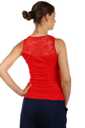 Women's elegant longer cut. The round neck is decorated with fringes. The upper part is completed with lace at the top.