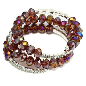 Non-traditional spiral bracelet. A combination of cut beads and strass stones. Diameter 6 cm. Several colors to choose from.