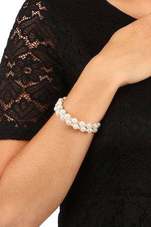 Beautiful spiral bracelet, combination of pearls and strass stones. Diameter 6.5 cm.