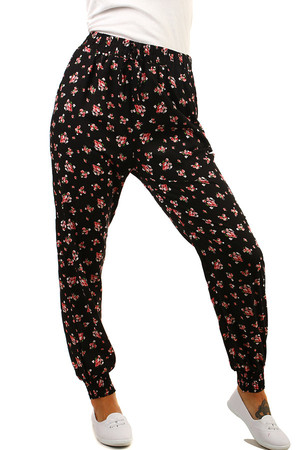 Long women's patterned rubber trousers. Comfortable fit. Material: 65% cotton, 35% polyester.