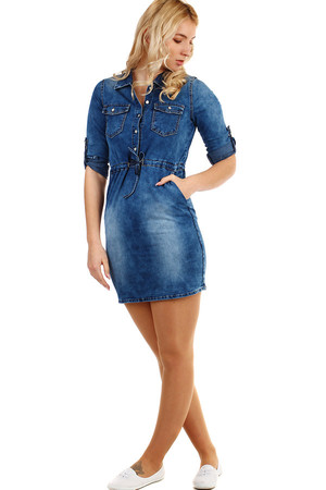 Women's denim dress with squeezing. Sleeves can be worn long or three-quarter, fixed with a button. The shade of the