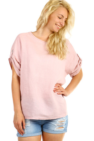 Women's linen oversized short sleeve blouse. The sleeves can be folded and secured with a knob. The back is slightly