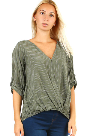 Stylish ladies polka dot blouse with three-quarter sleeves and V-neck. The bottom hem is elastic, the back slightly