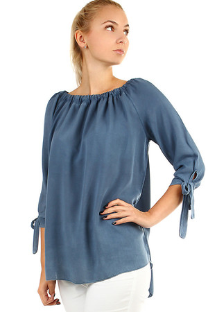 Elegant ladies blouse with free cut with sewn rubber in the neckline. The sleeves are three-quarter, at the end of the